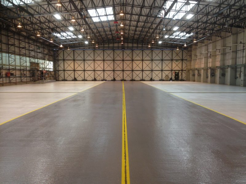 Hangar floor with epoxy demarcation areas and epoxy line markings