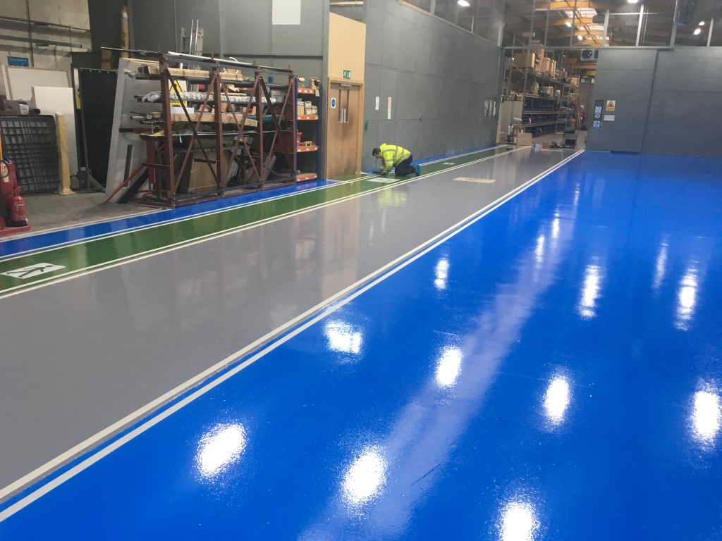 Resin flooring safety markings ready to be installed in a Manchester factory